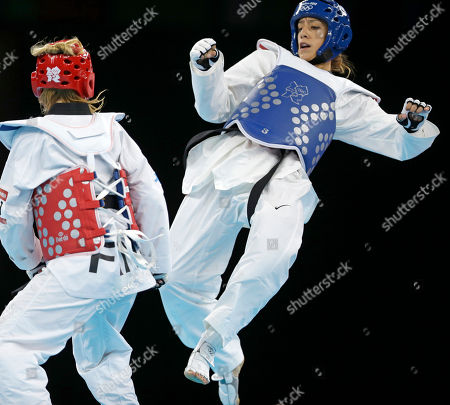 United States' Diana Lopez fights Finland's Suvi Mikkonen (in red) during their match in women's 57-kg taekwondo competition at the 2012 Summer Olympics, in London