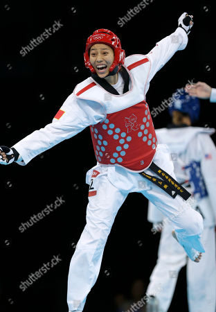 China's Hou Yuzhuo celebrates after defeating United States' Diana Lopez in women's 57-kg taekwondo competition at the 2012 Summer Olympics, in London