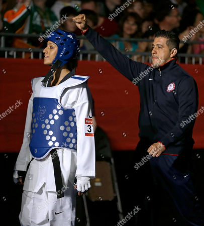 United States' Diana Lopez makes her way to fight China's Hou Yuzhuo in women's 57-kg taekwondo competition at the 2012 Summer Olympics, in London