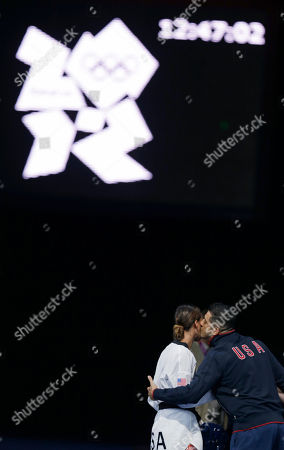 United States' Diana Lopez gets a kiss from her coach Jean Lopez, right, after losing to China's Hou Yuzhuo in women's 57-kg taekwondo competition at the 2012 Summer Olympics, in London