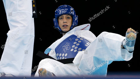 United States' Diana Lopez sits on the mat during her match against China's Hou Yuzhuo in women's 57-kg taekwondo competition at the 2012 Summer Olympics, in London