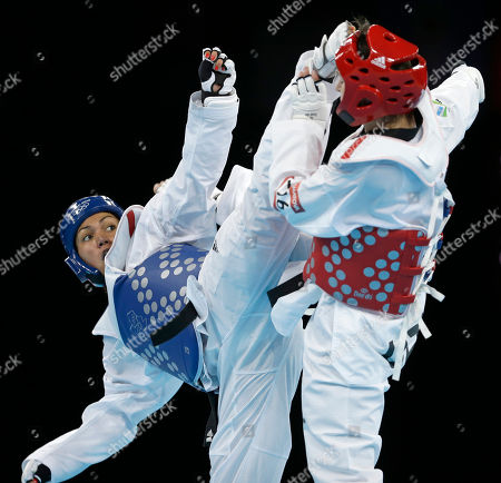 France's Anne-Caroline Graffe fights Uzbekistan's Natalya Mamatova (in red) during their match in women's plus 67-kg taekwondo competition at the 2012 Summer Olympics, in London
