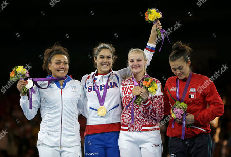 Gold medalist Serbia's Milica Mandic, second from left, stands on the podium with silver medalist France's Anne-Caroline Graffe, left, bronze medalist Russia's Anastasia's Baryshinkova and bronze medalist Mexico's Maria del Rosario Espinoza, right, during the medal ceremony for the women's plus 67-kg taekwondo competition at the 2012 Summer Olympics, in London