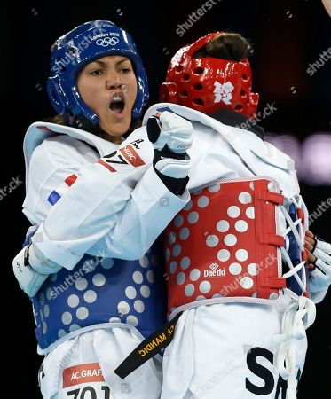 France's Anne-Caroline Graffe fights Serbia's Milica Mandic (in red) during the gold medal match in women's plus 67-kg taekwondo competition at the 2012 Summer Olympics, in London