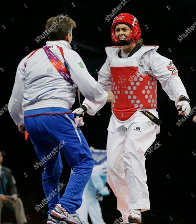 Serbia's Milica Mandic celebrates after defeating France's Anne-Caroline Graffe in the gold medal match in women's plus 67-kg taekwondo competition at the 2012 Summer Olympics, in London