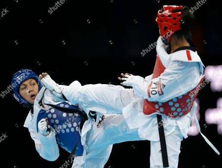 France's Anne-Caroline Graffe fights Cuba's Glenhis Hernandez (in red) during their semifinal round match in women's plus 67-kg taekwondo competition at the 2012 Summer Olympics, in London