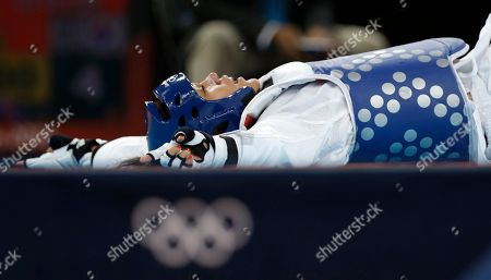 France's Anne-Caroline Graffe celebrates after defeating South Korea's In Jong Lee in their quarterfinal round match in women's plus 67-kg taekwondo competition at the 2012 Summer Olympics, in London