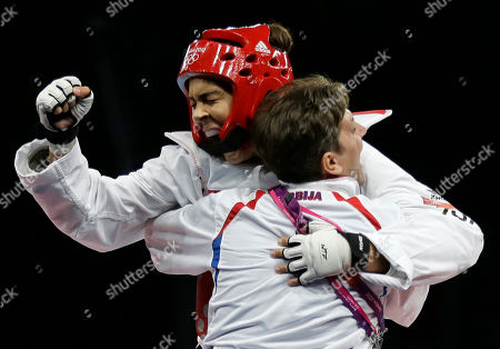 Serbia's Milica Mandic celebrates after defeating France's Anne-Caroline Graffe, left, in the gold medal match in women's plus 67-kg taekwondo competition at the 2012 Summer Olympics, in London
