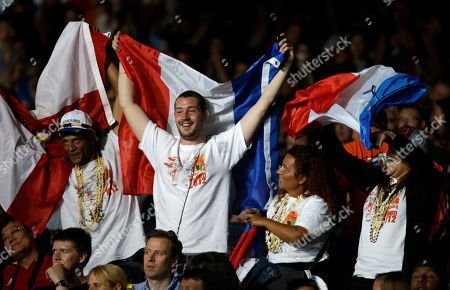 Fans cheer as France's Anne-Caroline Graffe fights Cuba's Glenhis Hernandez in their semifinal round match in women's plus 67-kg taekwondo competition at the 2012 Summer Olympics, in London