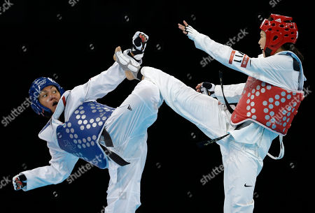 France's Anne-Caroline Graffe fights South Korea's In Jong Lee (in red) during their quarterfinal round match in women's plus 67-kg taekwondo competition at the 2012 Summer Olympics, in London