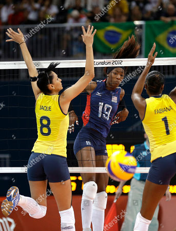 Fabiana Claudino, Jaqueline Carvalho, Destinee Hooker USA's Destinee Hooker (19) watches her spike get past Brazil's Jaqueline Carvalho (8) and Fabiana Claudino (1) during a women's volleyball gold medal match at the 2012 Summer Olympics, in London