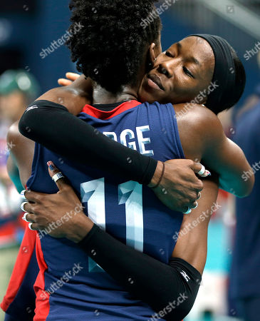 USA's Destinee Hooker (19, right) hugs teammate Megan Hodge (11) after the team lost to Brazil 3-1during a women's volleyball gold medal match at the 2012 Summer Olympics, in London