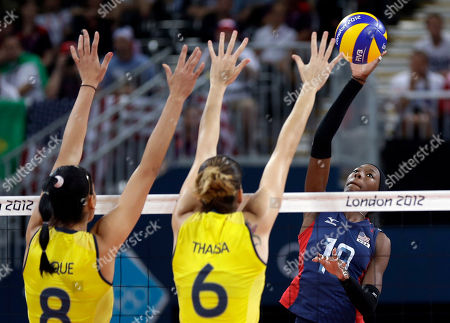 USA's Destinee Hooker (19, right) prepares to smash the ball past Brazil's Jaqueline Carvalho (8) and Thaisa Menezes (6) during a women's volleyball gold medal match at the 2012 Summer Olympics, in London