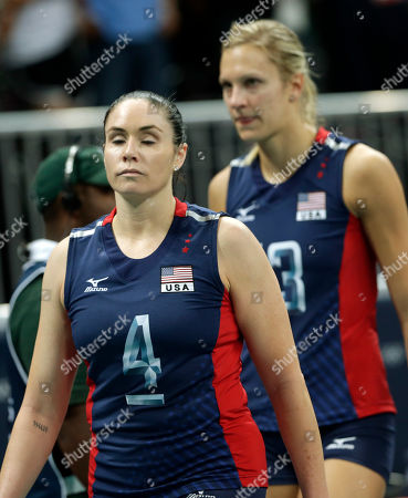 Stock Picture of United States' Lindsey Berg, front, and Christa Harmotto walk off the court after a loss to Brazil during the women's gold medal volleyball match at the 2012 Summer Olympics, in London