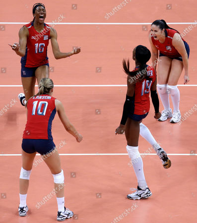 Stock Photo of Lindsey Berg, Foluke Akinradewo, Destinee Hooker, Jordan Larson Members of team United States, clockwise from top left, Foluke Akinradewo, Lindsey Berg, Destinee Hooker and Jordan Larson celebrate after defeating South Korea in a women's semifinal volleyball match at the 2012 Summer Olympics, in London