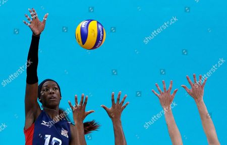 Destinee Hooker United States' Destinee Hooker, left, spikes the ball over defenders from Brazil during a women's gold medal volleyball match at the 2012 Summer Olympics, in London