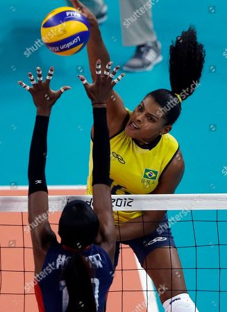 Destinee Hooker, Fernanda Rodrigues Brazil's Fernanda Rodrigues, top, spikes the ball over United States' Destinee Hooker during a women's gold medal volleyball match at the 2012 Summer Olympics, in London