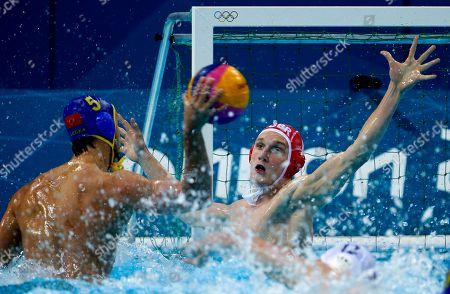 Ed Scott, Gragan Draskovic Gragan Draskovic, left, of Montenegro shoots against goalkeeper Ed Scott of Britain during a preliminary men's water polo match at the 2012 Summer Olympics, in London. Hungary won 11-6