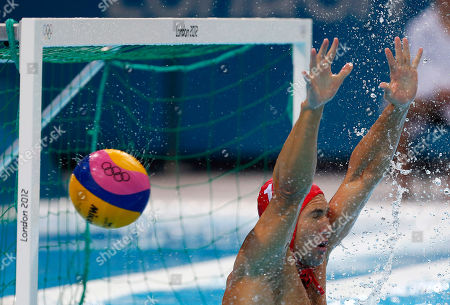 Merrill Moses A shot by Hungary's Marton Szivos enters the net of United States goalkeeper Merrill Moses during a preliminary men's water polo match at the 2012 Summer Olympics, in London