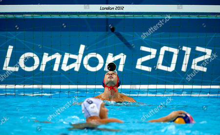 Merrill Moses, Norbert Hosnyanszky United States goalkeeper Merrill Moses, top, looks up as Norbert Hosnyanszky of Hungary waits for the signal to shoot a penalty during a preliminary men's water polo match at the 2012 Summer Olympics, in London. Hungary won 11-6