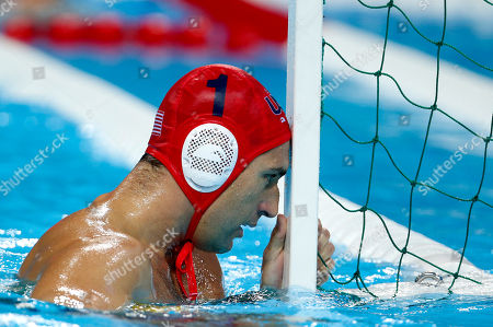 Merrill Moses United States goalkeeper Merrill Moses reacts after Spain's Felipe Perrone Rocha scored a goal on him during a men's semifinal fifth to eighth place water polo match at the 2012 Summer Olympics, in London. Spain won 8-7