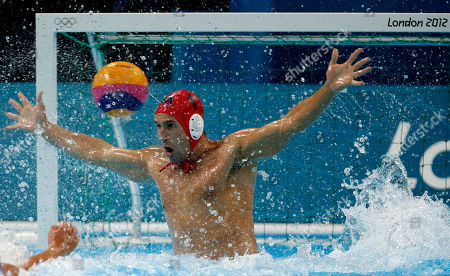 Merrill Moses United States goalkeeper Merrill Moses is unable to stop a shot by Spain's Felipe Perrone Rocha during a men's semifinal fifth to eighth place water polo match at the 2012 Summer Olympics, in London