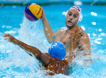 Paulo Obradovic, Amaurys Perez Croatia's Paulo Obradovic, top, shoots against Italy's Amaurys Perez during the men's water polo gold medal match at the 2012 Summer Olympics, in London