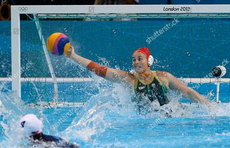 Goalkeeper Victoria Brown of Australia makes a save from a penalty taken by Brenda Villa of the United States, during their women's semifinal water polo match at the 2012 Summer Olympics, in London