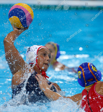 Brenda Villa of the United States shoots at goal during their women's water polo gold medal match against Spain at the 2012 Summer Olympics, in London