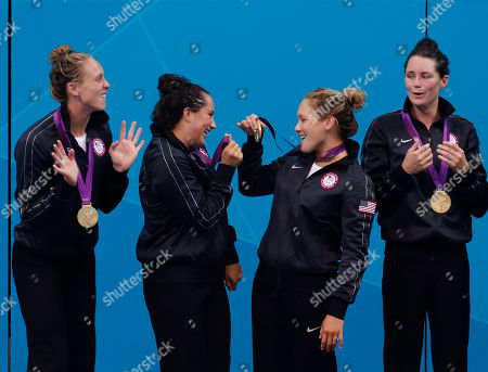 Lauren Wenger, left, Maggie Steffens, Courtney Mathewson and Jessica Steffens of the United States show off their gold medals during the medal ceremony for the women's water polo at the 2012 Summer Olympics, in London