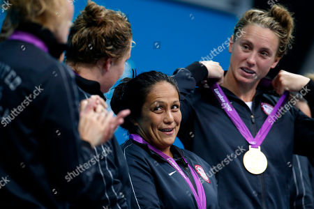Brenda Villa, Lauren Wenger United States' Brenda Villa, center, reacts as Lauren Wenger, right, adjusts her medal during the gold medal ceremony after the U.S. beat Spain 8-5 in the women's water polo gold medal match at the 2012 Summer Olympics, in London