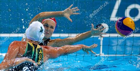 Flora Bolonyai, Holly Lincoln-Smith Holly Lincoln-Smith, center, of Australia scores a goal against goalkeeper Flora Bolonyai of Hungary during the bronze medal women's water polo match at the 2012 Summer Olympics, in London