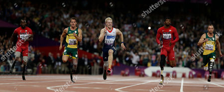 Jonnie Peacock, centre, of Britain competes in the men's 100-meter T44 category final, with Blake Leeper, left of the United States, Amu Fourie, second left, of South Africa Richard Browne, second right of the United States and Oscar Pistorius, right, of South Africa at the 2012 Paralympics games, in London