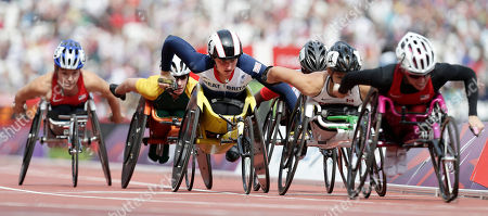 Shelly Woods, centre. of Britain competes in a women's 1500-meter T54 category heat at the 2012 Paralympics games, in London