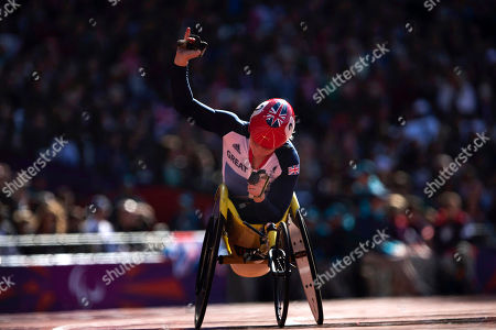 Britain's Shelly Woods waves after competing in a women's 5000m T54 round 1 race at the 2012 Paralympics in London