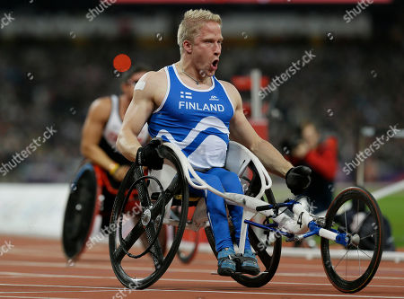 Finland's Leo Pekka Tahti celebrates as he wins gold in the men's 100m T54 final at the 2012 Paralympics, in London