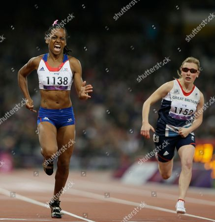 France's Mandy Francois-Elie, left, crosses the finish line to win gold, Britain's Katrina Hart,right, in the women's 100m T37 final at the 2012 Paralympics, in London
