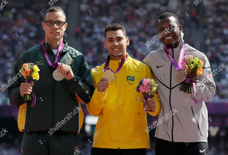 South Africa's Oscar Pistorius with the silver, left, Brazil's Alan Fonteles Cardoso Oliveira with the gold, center, and Blake Leeper of the United States with the bronze, right, at the medal ceremony for the men's 200m T44 at the 2012 Paralympics, in London