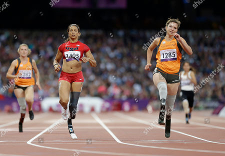 United States' April Holmes, left, and Netherlands' Mariou Van Rhijn, right, competes at a women's 100m T44 round 1 race at the 2012 Paralympics in London, . Van Rhijn ran a new world record in the race of 13.27 seconds
