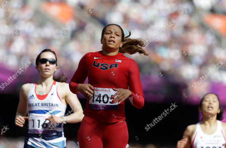 United States' April Holmes, center, finishes a women's 200m T44 round 1 race at the 2012 Paralympics, in London