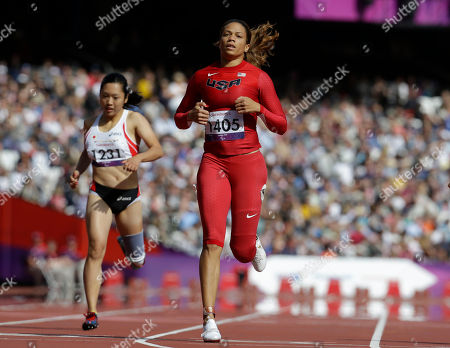 Stock Picture of United States' April Holmes, center, finishes a women's 200m T44 round 1 race at the 2012 Paralympics, in London