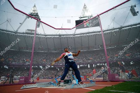 Britain's Derek Derenalagi makes a throw in the men's discus throw F57/58 category during the athletics competition at the 2012 Paralympics, in London. Derenalagi, who is originally from Fiji, required amputation on his legs after his vehicle was hit by an improvised explosive device in 2007 whilst serving for the British military in Afghanistan
