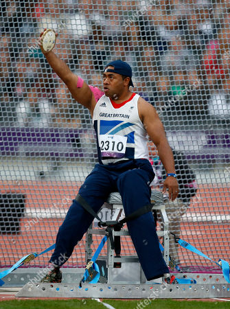 Britain's Derek Derenalagi prepares to make a throw in the men's discus throw F57/58 category during the athletics competition at the 2012 Paralympics, in London. Derenalagi, who is originally from Fiji, required amputation on his legs after his vehicle was hit by an improvised explosive device in 2007 whilst serving for the British military in Afghanistan