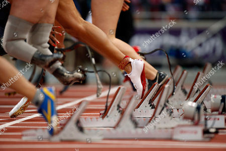 Stock Photo of The shoe and ankle bracelet of April Holmes of the U.S. come off the blocks as she makes a start during a women's 100m T44 round 1 race at the 2012 Paralympics in London