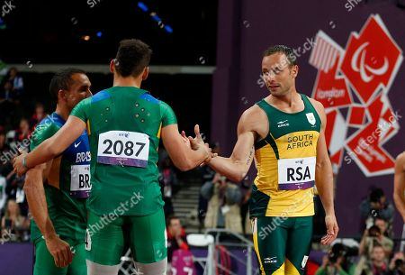 Gold medalist South Africa's Oscar Pistorius, third left, shakes hands with silver medalist Brazil's Alan Fonteles Cardoso Oliveira, second left, after South Africa set a new world record of 41.78 seconds in the men's 4x100m relay T42/46 category final during the athletics competition at the 2012 Paralympics, in London
