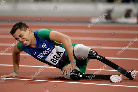 Silver medalist Brazil's Alan Fonteles Cardoso Oliveira lies on the track after South Africa set a new world record of 41.78 seconds in the men's 4x100m relay T42/46 category final during the athletics competition at the 2012 Paralympics, in London