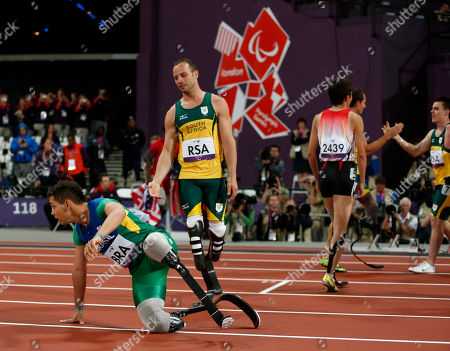 Gold medalist South Africa's Oscar Pistorius, second left, offers his hand to shake with silver medalist Brazil's Alan Fonteles Cardoso Oliveira, left, after South Africa set a new world record of 41.78 seconds in the men's 4x100m relay T42/46 category final during the athletics competition at the 2012 Paralympics, in London