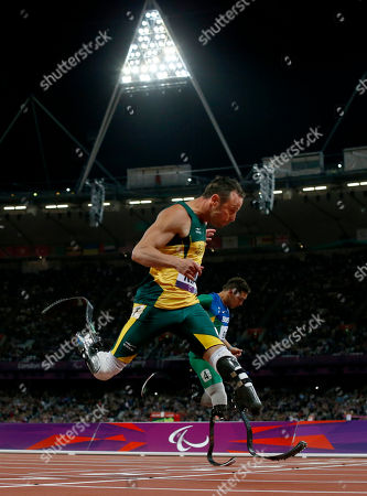 Gold medalist South Africa's Oscar Pistorius, foreground, sets a new world record of 41.78 seconds as he crosses the line ahead of Brazil's Alan Fonteles Cardoso Oliveira in the men's 4x100m relay T44 category final during the athletics competition at the 2012 Paralympics, in London