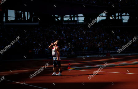 Stock Image of Britain's Kyron Duke requests quiet from the crowd during the men's javelin throw F40 category final during the athletics competition at the 2012 Paralympics, in London