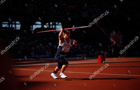 Britain's Kyron Duke runs in to throw during the men's javelin throw F40 category final during the athletics competition at the 2012 Paralympics, in London